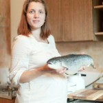 pregnant woman with fish