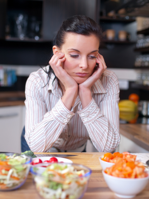 Depressed woman uninterested in food