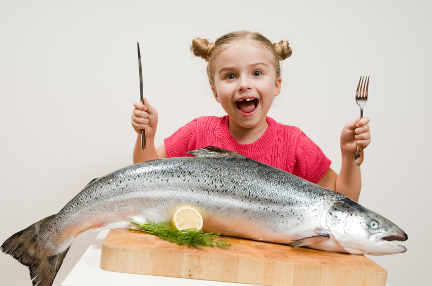 girl eating fish
