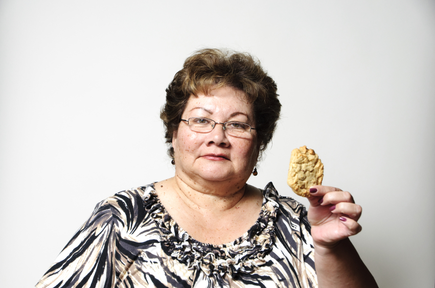woman considering eating a cookie