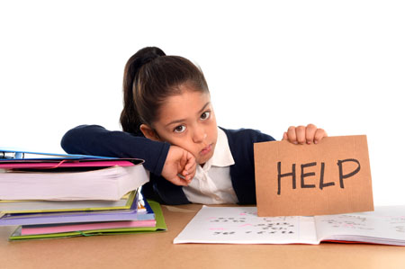 "young girl holding ""help"" sign"