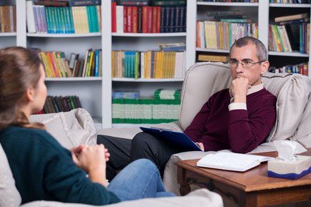 woman speaking with therapist